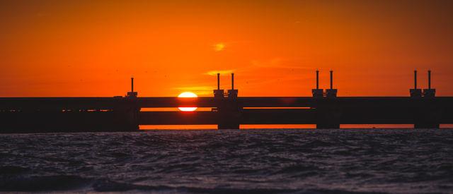 Oosterschelde storm surge barrier sunset