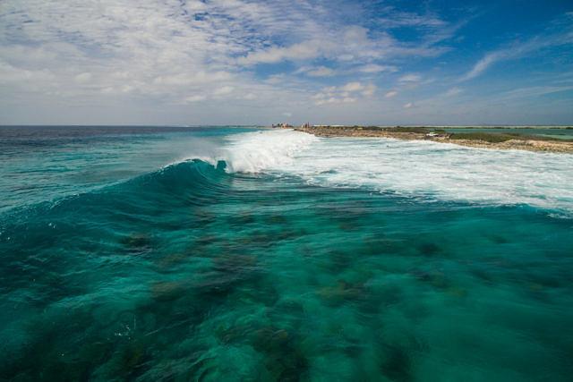 Waves at slave huts