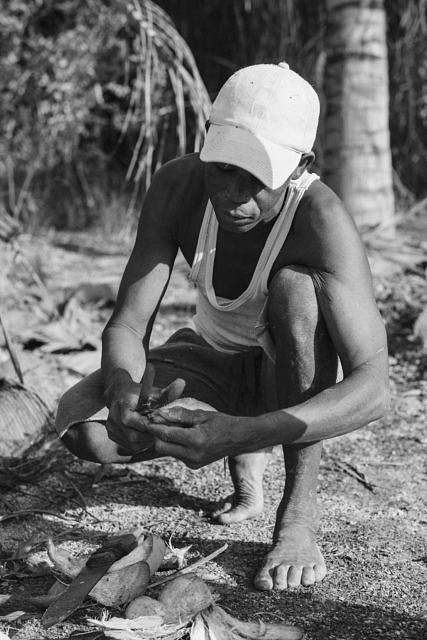 Kenya - Mombasa, getting a fresh coconut from a local farmer