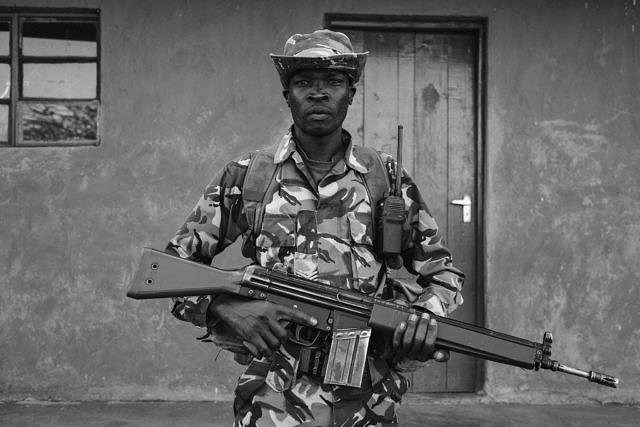 Kenya - Borana, armed rangers ready for the briefing of the night patrol